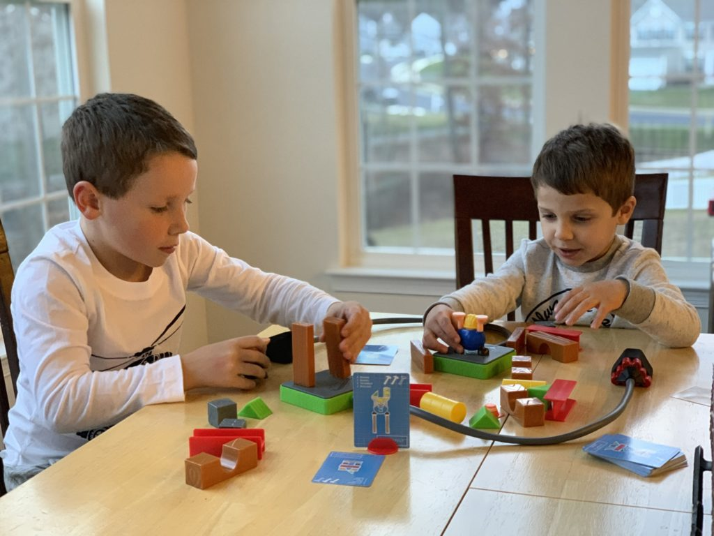 two boys playing the Build or Boom Goliath Game